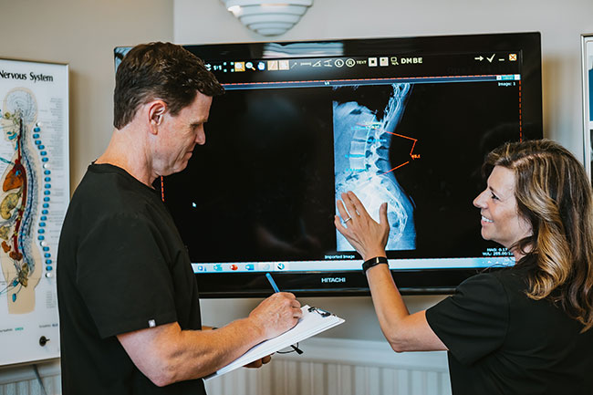 Chiropractor Rocklin CA Scott Beavers and Marianne Abate Reviewing X-Ray